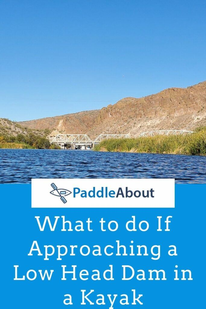 What should you do if you approach a low head dam in a kayak