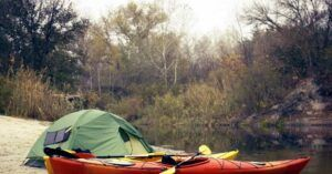 Kayak camping - Kayak camping on a beach