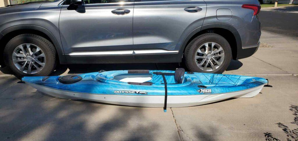 Load a kayak on a j rack - kayak positioned next to the car