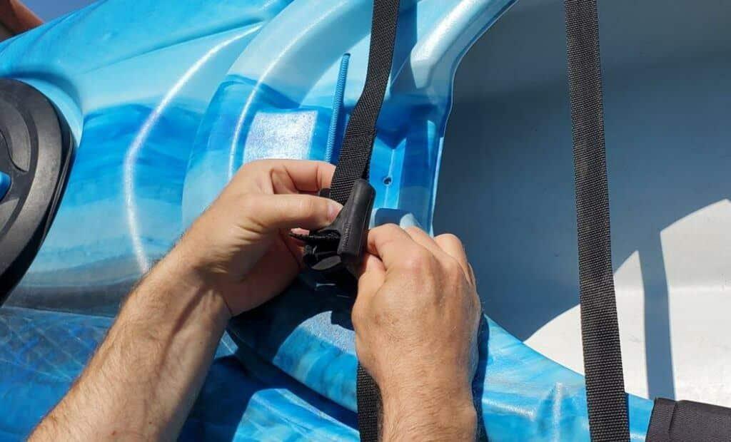 Loading a kayak on a j rack feeding the strap through the cam buckle