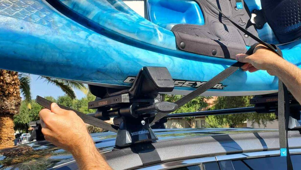 Strapping a kayak to a j rack - looping the straps around the crossbar