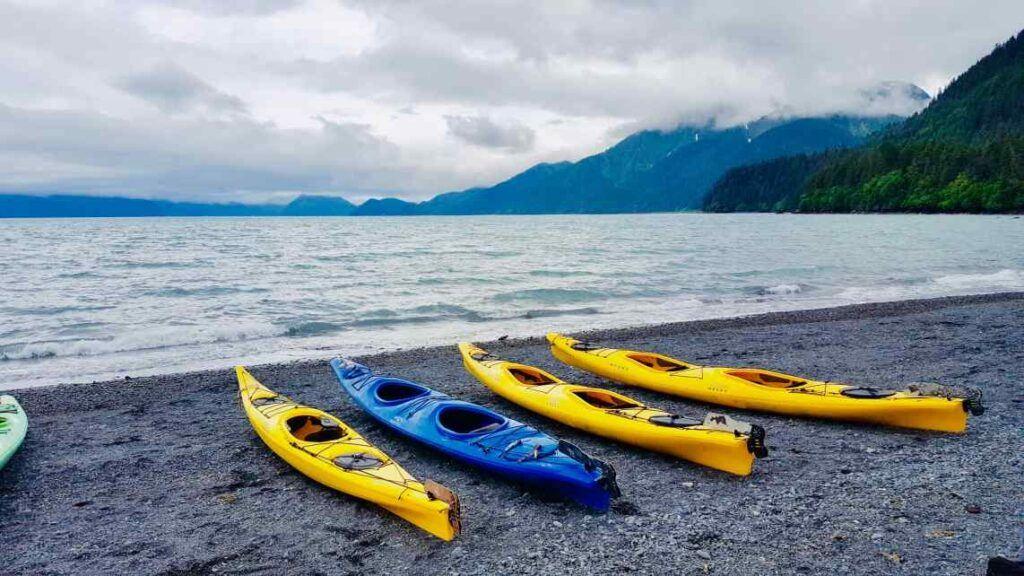 Best kayak brand - Yellow and blue kayaks on the beach