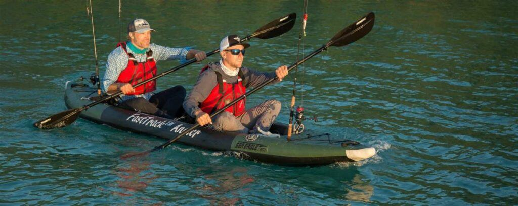 Two men paddling Sea Eagle 385fta tandem fishing kayak
