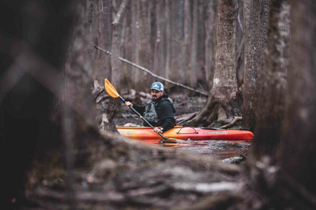 Tandem fishing kayak - man kayaking