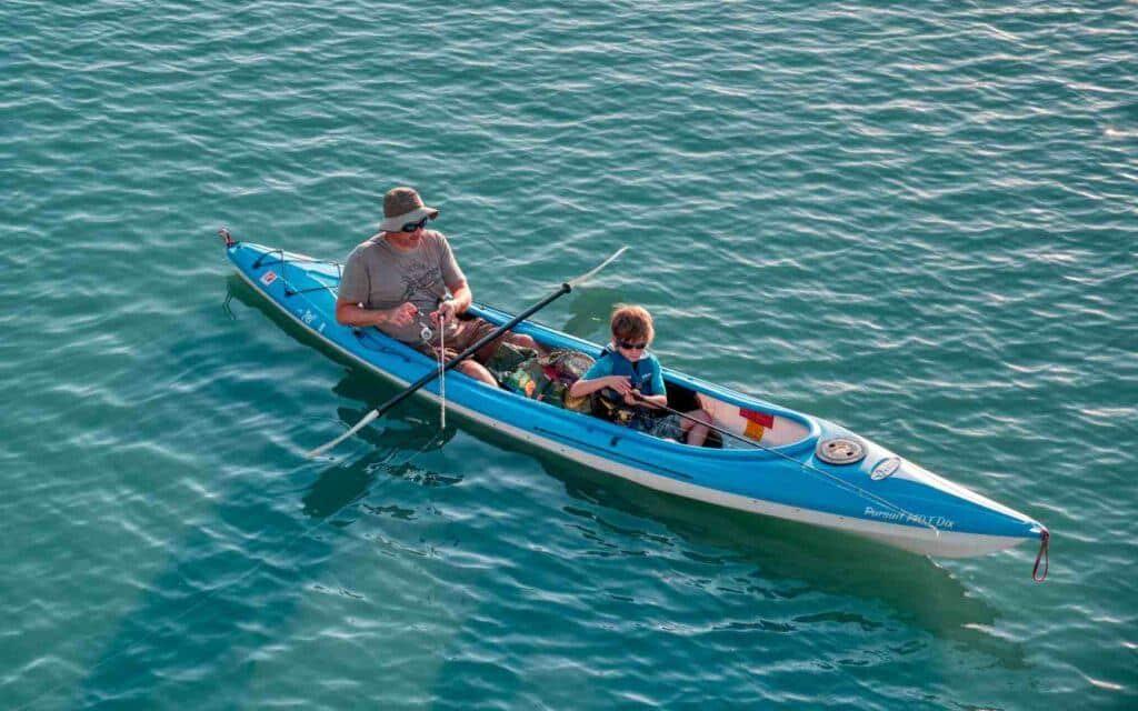 best tandem fishing kayak - man fishing with his son