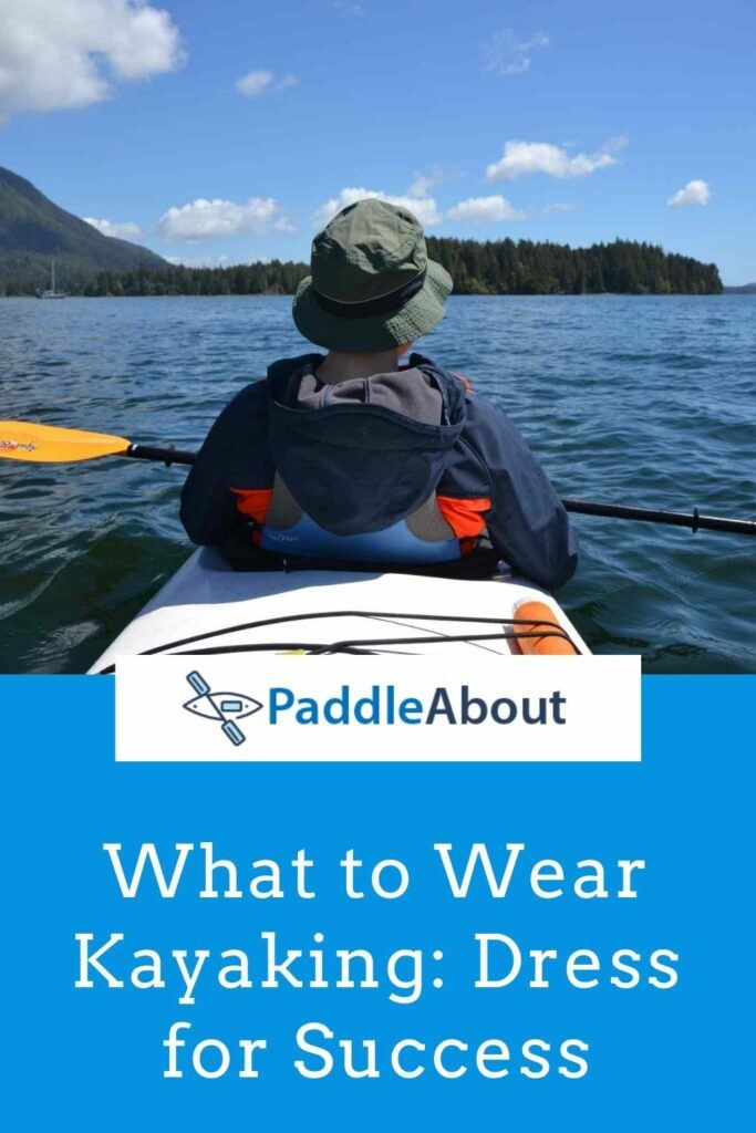 Clothes to wear kayaking - A man wearing a jacket and a hat on a kayak