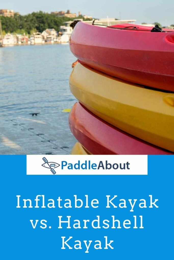 Inflatable vs. hardshell kayak - kayaks stacked on a dock