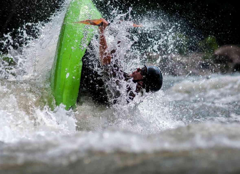 Kayak types - A man in a whitewater kayak